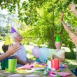 Happy family celebrating a birthday — Stock Photo #69010941