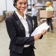 Warehouse manager holding clipboard — Stock Photo #69011847