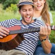 Cute couple relaxing in the park — Stock Photo #69012095