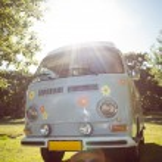 Retro camper van in a field — Stock Photo #69012491