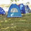 Blue tents in the campsite — Stock Photo #69012977