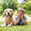 Little boy with his dog in the park — Stock Photo #69013267