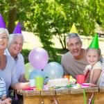 Happy family celebrating a birthday — Stock Photo #69013571