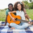 Couple on picnic playing guitar — Stock Photo #69013785
