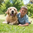 Little boy with his dog in the park — Stock Photo #69014681