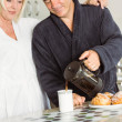 Mature couple having breakfast together — Stock Photo #69015071