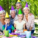 Happy family celebrating a birthday — Stock Photo #69015969