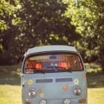 Retro camper van in a field — Stock Photo #69016389