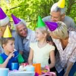 Happy family celebrating a birthday — Stock Photo #69016951