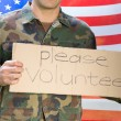 American soldier holding recruitment sign — Stock Photo #69017357