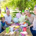 Happy family celebrating a birthday  — Stock Photo #69018785