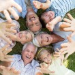 Stretched out family raising up their hands — Stock Photo #69019161