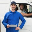 Delivery driver checking his list on clipboard — Stock Photo #69019343