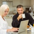 Mature couple having breakfast together — Stock Photo #69019661