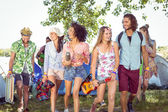 Young friends arriving at their campsite — Stockfoto