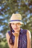 Pretty hipster blowing a kiss — Stock Photo