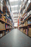 Shelves with boxes in warehouse — Stock Photo