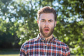 Shocked hipster looking at camera — Stock Photo