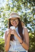Pretty brunette having coffee to go — Stock Photo