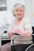 Sad senior patient sitting in wheelchair — Stock Photo