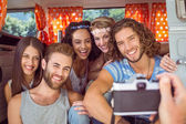 Hipster friends in a camper van — Stock Photo