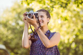Pretty hipster taking a photo — Stock Photo