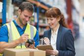 Worker and manager scanning package in warehouse — Stock Photo