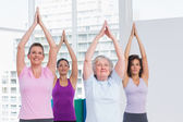 Friend with hands clasped exercising in gym — Stock Photo