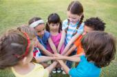 Little children putting hands together — Stock Photo