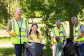 Happy family collecting rubbish  — Stock Photo