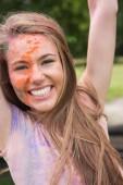 Woman having fun with powder paint — Stock Photo