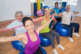 People exercising with resistance bands in gym — Stok fotoğraf