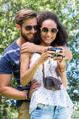 Hipster couple looking at their camera — Foto de Stock