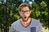 Shocked hipster looking at camera — Stock Photo