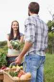 Woman selling organic vegetables at market — Stock Photo