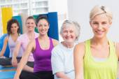 Women practicing yoga during fitness class  — Stock Photo