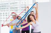 Happy female friends exercising with resistance bands — Стоковое фото