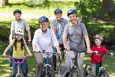 Happy family on their bike at the park — Stock Photo