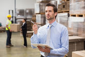 Warehouse manager checking his inventory — Stock Photo
