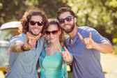 Hipster friends smiling at camera — Stock Photo