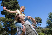 Father and daughter having fun in the park — Stock Photo