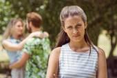 Brunette upset at seeing boyfriend with girl — Stock Photo