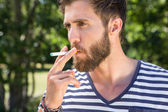 Hipster smoking electronic cigarette — Stock Photo