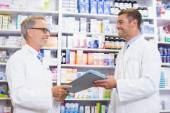 Team of pharmacists holding clipboard — Stock Photo