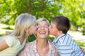 Sister and brother kissing their mother — Stock Photo