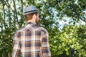 Handsome hipster walking in the park — Stock Photo