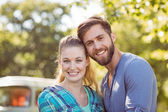 Hipster couple smiling at camera — Stock Photo