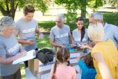 Volunteer family separating donations stuffs — Stock Photo