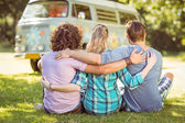 Hipsters sitting on the grass — Stock Photo