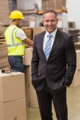 Boss standing with hands in pockets — Stock Photo